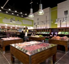 Idea Natura Sustainable Local Food Store by CB'a    Sleek design ideas - if that's how we go. Bright, clean, fresh.