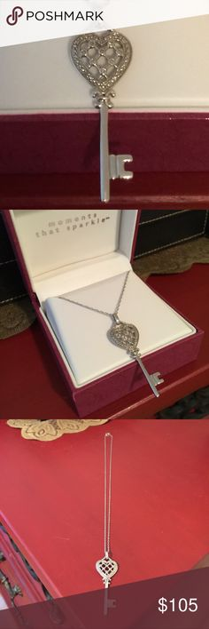 """EXQUISITE DIAMOND KEY TO HEART❤️ RETAIL $225+ 💎 HELZBERG DIAMONDS  ✔️website - Price is Firm   Unlock the door to love with this Diamond Key Necklace.  Pendant is approx 1/10 cwt. in 14K White Gold over .925 Sterling.  Chain is Sterling 18"""".  Quality piece.  Never Worn.    Comes with 2 boxes & gift bag.  Just beautiful❣(under Tiffany for search purposes) Tiffany & Co. Jewelry Necklaces"""