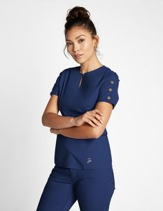 The Button Sleeve Top in Estate Navy Blue is a contemporary addition to women& medical scrub outfits. Shop Jaanuu for scrubs, lab coats and other medical apparel. Scrubs Outfit, Scrubs Uniform, Beautiful Nurse, Cute Scrubs, Lab Coats, Medical Uniforms, Womens Scrubs, Medical Scrubs, Best Sellers