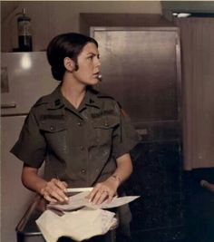 Women in Vietnam War ... She's a  Medical Service Corps Captain and is trying to finish a letter to the folks back home.   (1968)