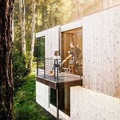 This tiny deck off the side of this modern cabin home proves that you don't need a lot of space to make a big statement.