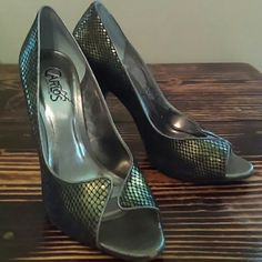 Carlos Santana heels Green iridescent faux snakeskin heels. Normal wear on the bottoms Tiny scuff on right toe (in picture) Carlos Santana Shoes Heels