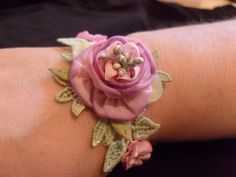 Ribbon flower braclet Pretty idea for (handmade) Ribbon flower bracelet. Please see my Handmade Flowers Board for ideas on how to make fabric and ribbon flowers. Ribbon Jewelry, Ribbon Art, Fabric Ribbon, Ribbon Crafts, Flower Crafts, Fabric Crafts, Ribbon Flower, Textile Jewelry, Fabric Jewelry