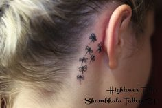 Tiny dragonfly tattoo - represents change/transformation