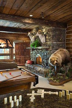 Within the open floor plan, handcrafted spruce king-post trusses, architectural lighting and a soaring fireplace account for part of the home's drama. Tom's hobby as a big game hunter provides the rest.