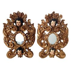 A Pair of striking wall mirrors in the Spanish Colonial style from South America. Likely dated from turn of the 20th Century. The frames were carved in the taste of Spanish Baroque style with elaborate foliage curves and further ornamented with two cherub heads each.