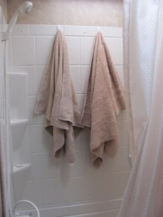 With a family of five and a very small camper bathroom, there are always wet towels or clothes and not enough places to hang them.  i have solved that problem with the use of Command hooks. Why didn't I think of this sooner?!