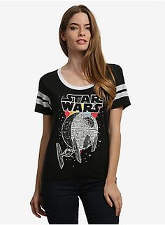"""<p>May the Force be with you every time you rock this cute retro-inspired t-shirt, featuring the classic Star Wars logo! With cool '70s colors and a graphic rendering of the Death Star, it's just like the Star Wars shirt your mom used to wear back in the day!</p>  <ul> <li style=""""LIST-STYLE-POSITION: outside !important; LIST-STYLE-TYPE: disc !important"""">65% cotton; 35% polyester</li> <li style=""""LIST-STYLE-POSITION: outside !important; LIST-STYLE-TYPE: disc !important"""">Wash cold; dry…"""