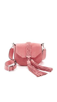 Exclusive to Shopbop and straight from Rebecca Minkoff's Spring 2016 runway! Oversized tassels and tonal knotwork lend bohemian appeal to this structured suede Rebecca Minkoff saddle bag. A snap secures the flap top, which opens to a lined interior with 1 card slot. Optional, adjustable shoulder strap.
