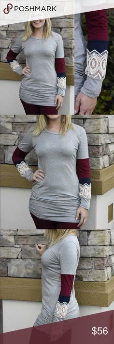 Grey Top With Lace Sleeves Our Grey Top With Lace Sleeves is ultra comfortable and has adorable color blocking that add extra interest to the sleeves!  Ruched on the sides near your hips.  Fitted and stretchy comfort.  Boutique pricing is firm. No trades Tops Tunics