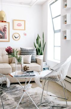 How to Arrange Furniture the Right Way. Calm, neutral living room with eclectic accessories. #theeverygirl