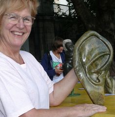 """amogis (Eveline Gisela Amort) with her sculpture """"The Sound of Silence"""", opale serpentine Stone Sculpture, Sculptures, Opal, Stone Carving, Sculpture"""