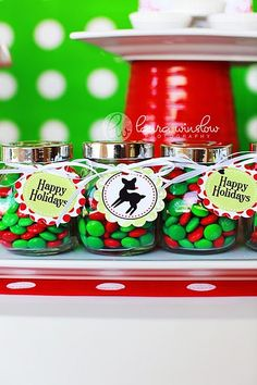 Repurposed baby food jars! Spray paint lids, add candy and a ribbon and cute tag!