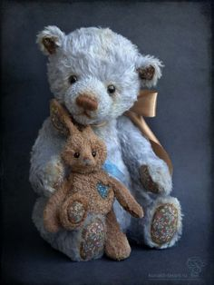 Adorable blue bear with his bunny.  I don't know the artist...