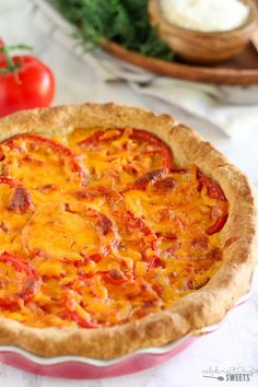 Savory Tomato Cheddar Pie - A buttermilk biscuit crust holds layers of ...