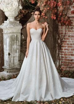 Beauty lies within the subtle details of this organza ball gown with allover lace appliques, a sweetheart neckline, natural waist, and monarch length train.
