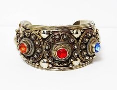 Large Cuff Bracelet with Red Golden and Blue Faceted Glass