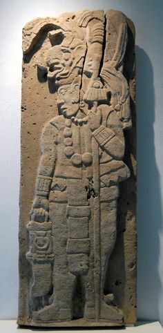 This stone carving depicts an ancient Maya man carrying a spear and a spear thrower. Tamayo museum of Oaxaca