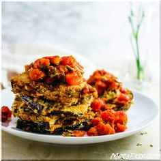 Each eggplant plank has a crispy and crunchy breaded exterior and is topped with a savory, garlicky basil-tomato sauce that is spicy.