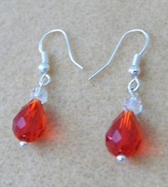 ".925 sterling silver French hook earrings on sterling silver pins with 6mm clear round Swarovski beads and 8x12mm red Swarovski teardrops that dangle 1 1/4""  now only $22.40  Clearance: 30% OFF UNTIL DECEMBER 20TH   GemsAndCrystalsEtc.ArtFire.com"