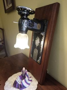 Steampunk Sewing Machine Wall Lamp (Collectibles) in Rancho Santa Fe, CA - OfferUp Sewing Machine Tables, Antique Sewing Machines, Sewing Table, Repurposed Furniture, Diy Furniture, Lamps For Sale, Scrap Metal Art, Sewing Art, Wood Slab