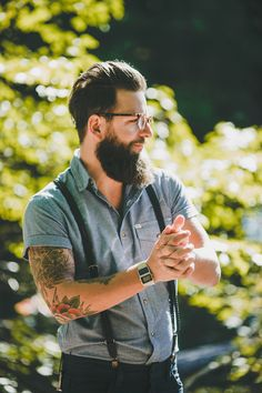 Loving this grooms look... glasses + beard + suspenders + short sleeves