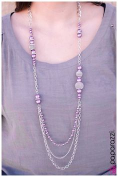 Extra long chunky silver chain with silver mesh balls and purple beads with a pearly shimmer scattered throughout. A short string of purple pearls and a dainty chain add dramatic length and style.  Sold as one individual necklace. Includes one pair of matching earrings.