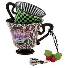 Disney Alice in Wonderland Tea Cup Ornament - The Cheshire Cat | Disney StoreAlice in Wonderland Tea Cup Ornament - The Cheshire Cat - You'll be simply mad for this decorative stacked tea cups ornament featuring a beaming Cheshire Cat and two Pencil Birds from Wonderland's Tulgey Wood, plus an array of enticing op art patterns.