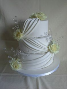 Fresh #roses,  #crystal #bling & #elegant #drapping #wedding #cake created by MJ www.mjscakes.co.nz in sunny Hawkes Bay NZ delivered to the gorgeous Mission Estate Winery Mj, Cake Decorating, Wedding Cakes, Roses, Bling, Fancy, Fresh, Crystals, Elegant