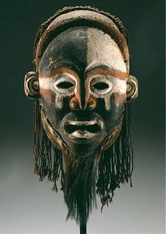 Africa | Mask from the Vili people of the lower Congo river, Brazzaville | Wood, pigment, plant fiber, hair, leopard skin | 19th century
