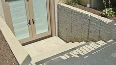 Outside basement entrance door remodeling ideas for Does a walkout basement cost more