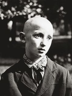 """Antanas Sutkus. """"Blind Pioneer"""" (1962) shows a blind child dressed in the scarf and outfit of a Young Pioneer, the children's organization operated by the Communist Party. Blindness here functions as a metaphor for unquestioned obedience to the state."""