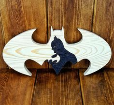 The Batman logo and silhouette is handcrafted and hand-burnt by myself. This is a unique take on the standard Batman logo and gives it an extra