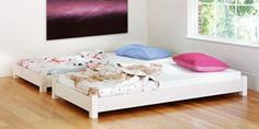 Amazing!!! Stacking beds for a shared bedroom or for sleepovers!