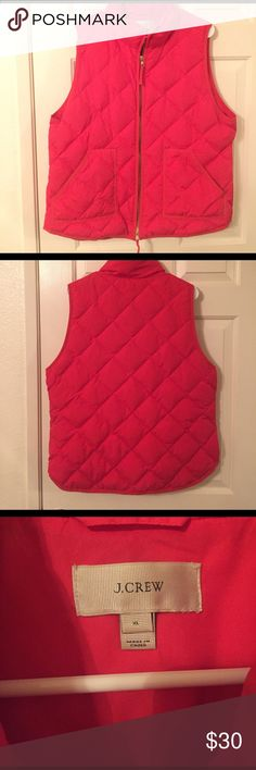 J.Crew red down vest J.Crew red zip up down vest size XL. length from shoulder to bottom hem is approx. 25 inches.  In great condition I noticed there are some small stains (shown in last picture) but they are hardly noticeable J. Crew Jackets & Coats Vests