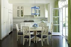 Anne Hepfer Designs: Playful white, blue and green accents, white Oly Studio coral side chairs, navy seat, pedestal dining table, calcutta marble, herringbone pattern, blue lantern pendant