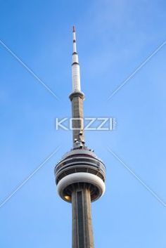 low angle shot of cn tower against sky. - Low angle view of CN tower against clear blue sky.