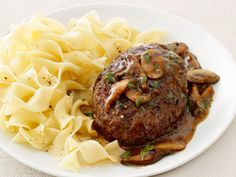 Smother ground beef and sage patties with a mixed mushroom sauce and serve with egg noodles for a cozy weeknight meal!