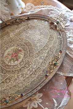 Make a pretty vanity tray or wall art from old picture frame or tray, paint and line with pretty laces or elegant doilies.