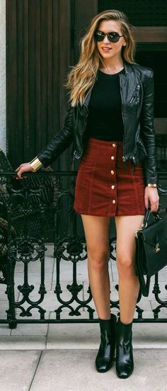 Nichole Ciotti wears the button front skirt trend with a cute leather jacket and ankle boots. Boots: M. Gemi.