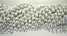 "33 inch 07mm Round Metallic Silver Mardi Gras Beads - 6 Dozen (72 necklaces) by Mardi Gras Spot. $11.50. Mardi Gras beads that have a multitude of uses.  To gain access for paid events, to add sparkle and color for your school team events or corporate functions, great for home parties to add that little something to your party theme.  33"" of 7mm thick beads of continuous color made of bright, shinny durable plastic.--33 inch 07mm Round Metallic Silver Mardi Gra..."