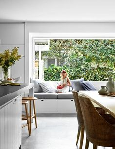 A bright weatherboard weekender dressed up for the festive season - Light streams into the open-plan dining space which features an elegant window seat. House Design, Home, New Homes, House Interior, Ultra Modern Homes, Interior Design, Patio Furniture Sets, Window Seat, Window Seat Design