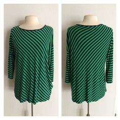 """Liz Claiborne striped top Liz Claiborne navy and green striped top. Size XL. 100% rayon. This has some stretch to it and it is very soft!! Excellent used condition - very very minimal pilling. Measures 28"""" long with a 40"""" bust. No trades I am very open to fair offers! Liz Claiborne Tops Tees - Long Sleeve"""