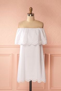 Laryssa #boutique1861 / This light white dress is perfect for your vacation at the beach, it is truly confortable. The off the shoulder sleeves are held up by an elastic. The embroidery and eyelet cutouts add a little something special.
