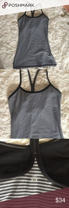 Lululemon Black power y tank with built in bra 4 Lululemon Black striped tank with built in bra. No pads, but can be added if desired. Size 4. In gently used condition. Reasonable offers always accepted. lululemon athletica Tops Tank Tops