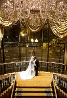 Johanna & Rich on the stairs, a Four Seasons Boston Wedding.