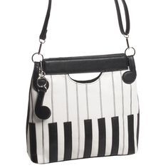 This sleek animal-friendly handbag has the look and touch of real leather, with embroidery detail on the keyboard design, and subtle eighth notes holding the shoulder strap.Vinyl, 12' x 11 1/2' x 3'. Double clutch handle with removable shoulder strap.