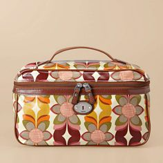 Vintage Key-Per Zip Top Train Case     NEW        Online Price              $    65                       We love to travel with accessories that stand out, and our Key-Per train case is definitely eye-catching. Colorful prints and versatile materials make it perfect for people on the go.