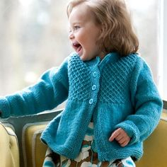 Free pattern for this smocked knit cardigan will delight the little princess in your life (@ WEBS)