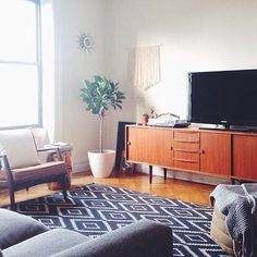 Love the mix of new + vintage in @kccesiro's place – featuring our Kite Kilim rug! #mywestelm #regram #livingroom